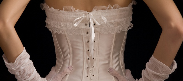 Rear view of girl in white corset